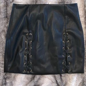 NWT BEBE FAUX BLACK LEATHER LACE UP SKIRT